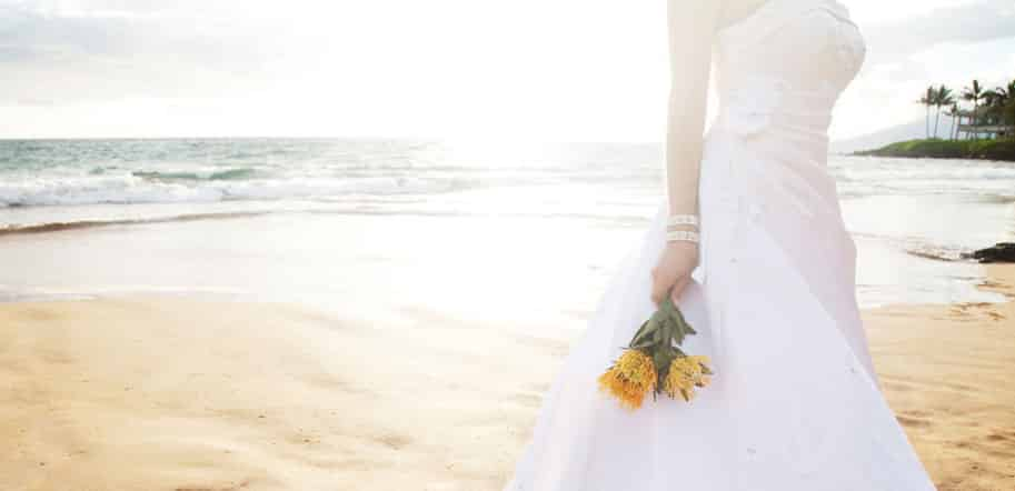 bride on the beach, all inclusive destination weddings, get swept away in love and luxury