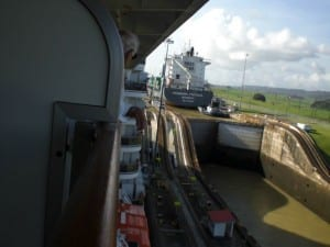 picture shows a freighter being elevated in the Panama canal next to our ship