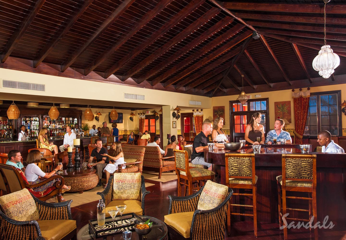 travelers in the martini bar at Sandals Whitehouse Jamaica, all inclusive vacations adults only can be booked