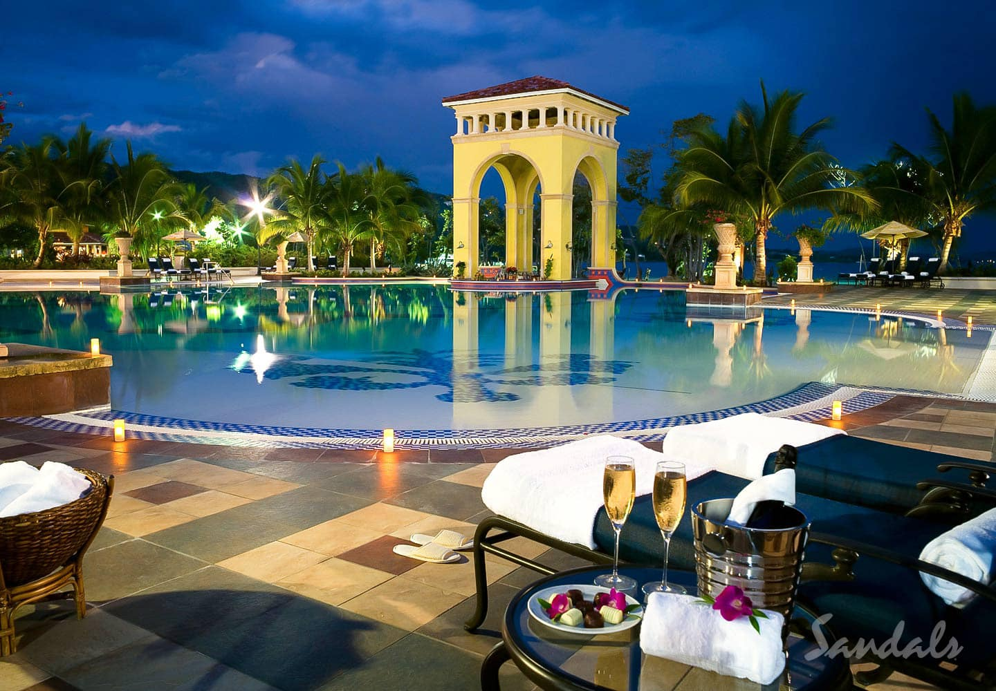 poolside, enjoying champagne at the Sandals Whitehouse Jamaica luxury resort, all inclusive vacations adults only booked through Southern Travel Agency Augusta, GA