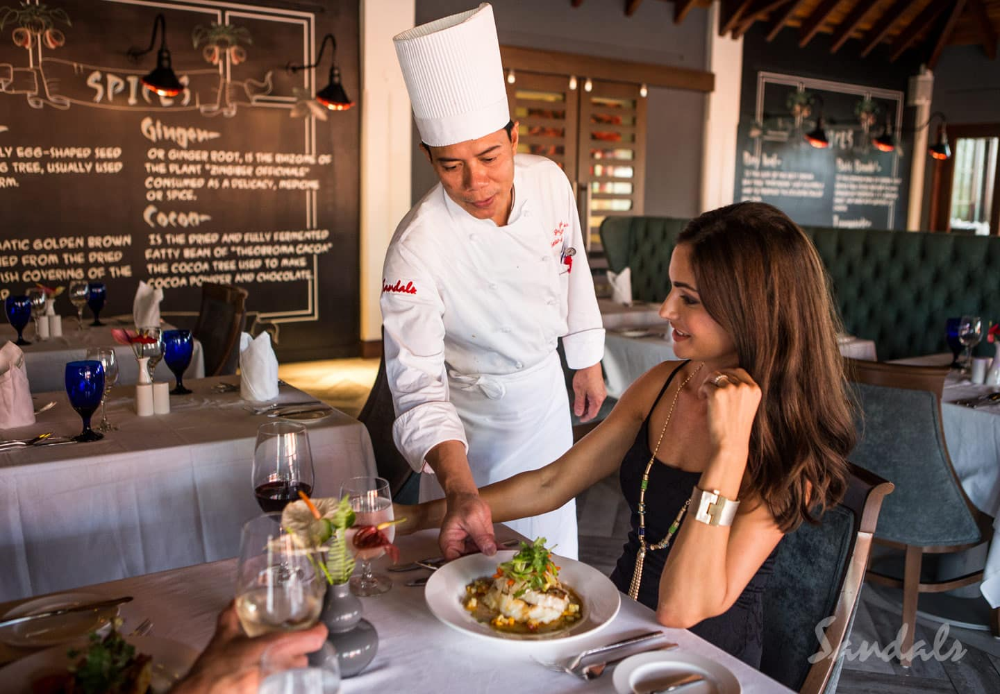 chef serves food to his guests at the Sandals LaSource Grenada luxury resort, adult only vacation can be booked with Southern Travel Agency Augusta, GA