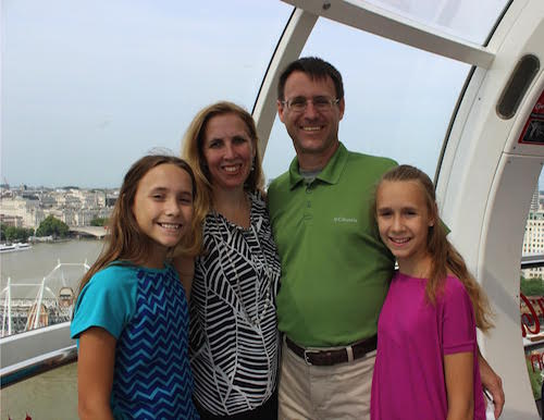 mother, father, and two daughters traveling through Europe
