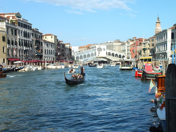 gondola ride in Venice, family vacation packages can be booked with Southern Travel Agency Augusta, GA