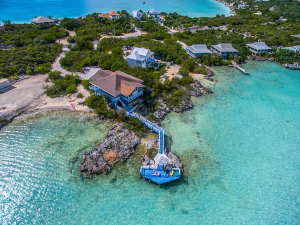 over-water-bungalows at Turks and Caicos family resorts, perfect to book as luxury all inclusive resorts for families during spring break