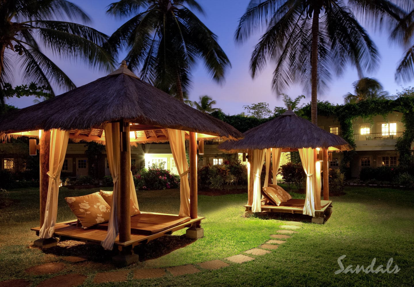 outside loungers in the night sky at the Sandals Halcyon Beach Resort in St Lucia, one of the all inclusive resorts adults only