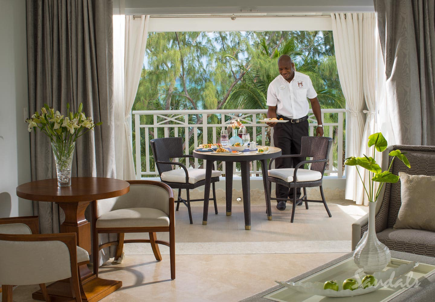 butler serving breakfast in private room at Sandals Barbados adult only resort, adult only vacation can be booked with Southern Travel Agency Augusta, GA