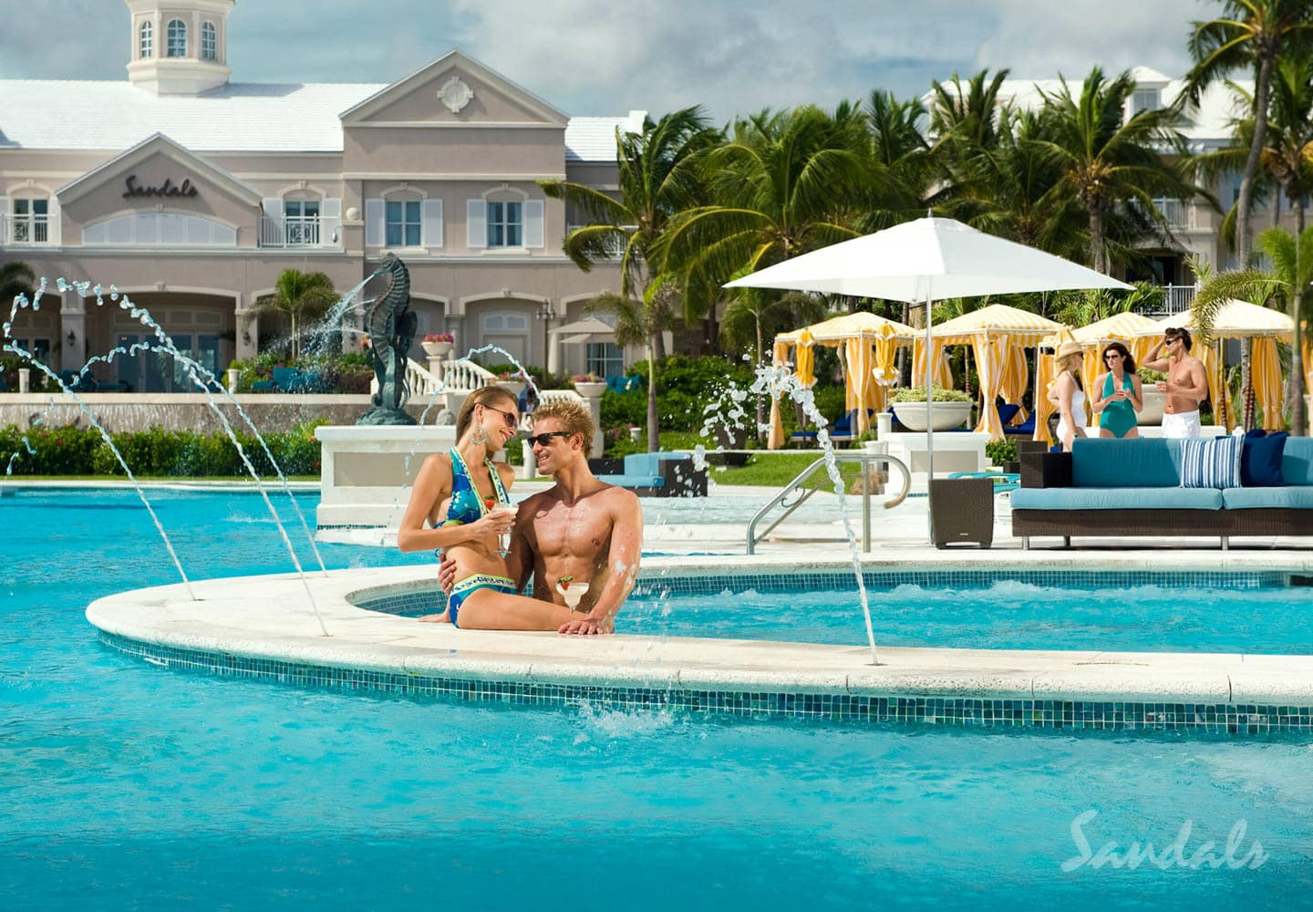couple in the swimming pool on their honeymoon vacation at Sandals Emerald Bay Resort, part of Southern Travel Agency's all inclusive honeymoon vacations offer