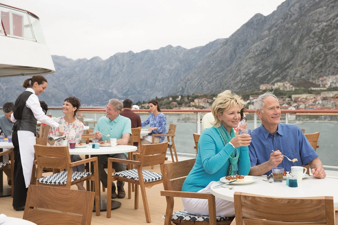 People dining on the Viking Ocean Cruise Star Aquavit Terrace during the day, luxury cruises, ask Southern Travel Agency Augusta, GA, for your customized travel itinerary