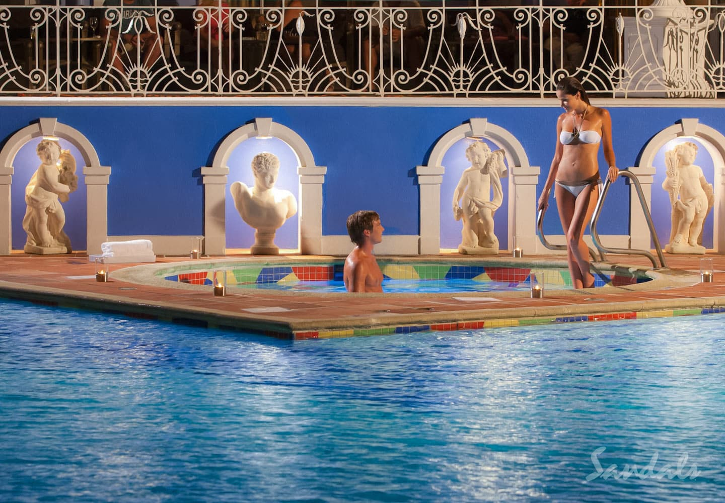 a couple in their private whirlpool at Sandals Royal Bahamian spa resort at the Bahamas, perfect location for luxury vacation packages, planned by Southern Travel Agency Augusta, GA