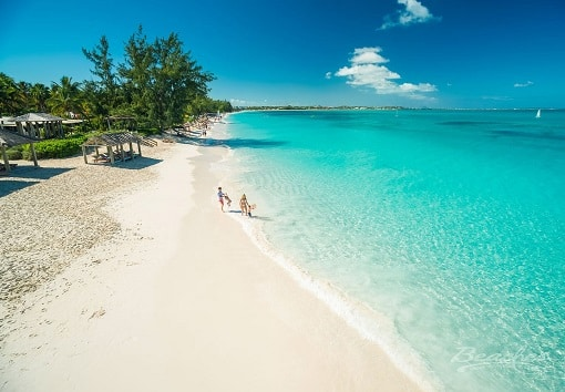 beautiful sandy beach and blue ocean water at Beaches Turks and Caicos family resort, family vacation packages can be booked through Southern Travel Agency Augusta, GA