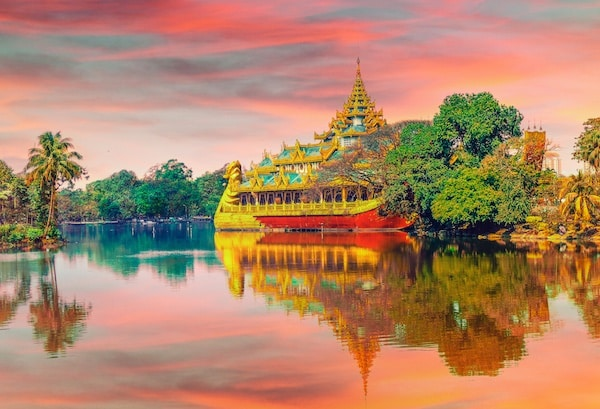 asian temple surrounded by a lake and bushes, symbolizing the best vacation in asia you can have.