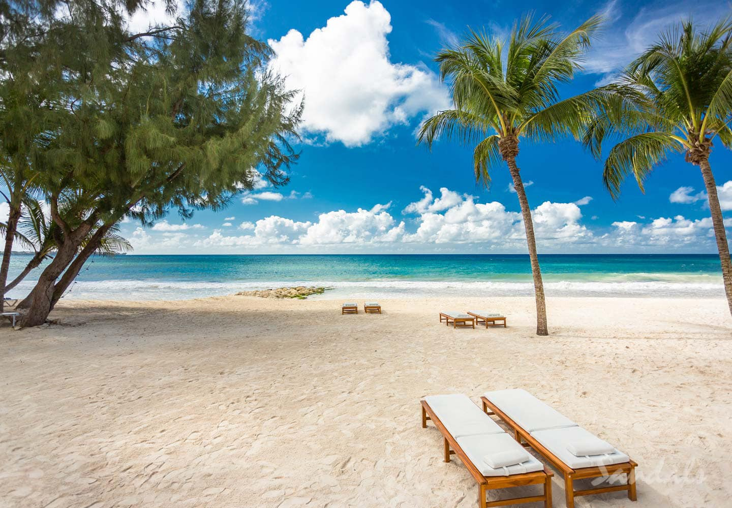 sandy beach and blue water at the Sandals Barbados Resort, well-known for luxury all inclusive vacations adults only, planned by Southern Travel Agency Augusta GA