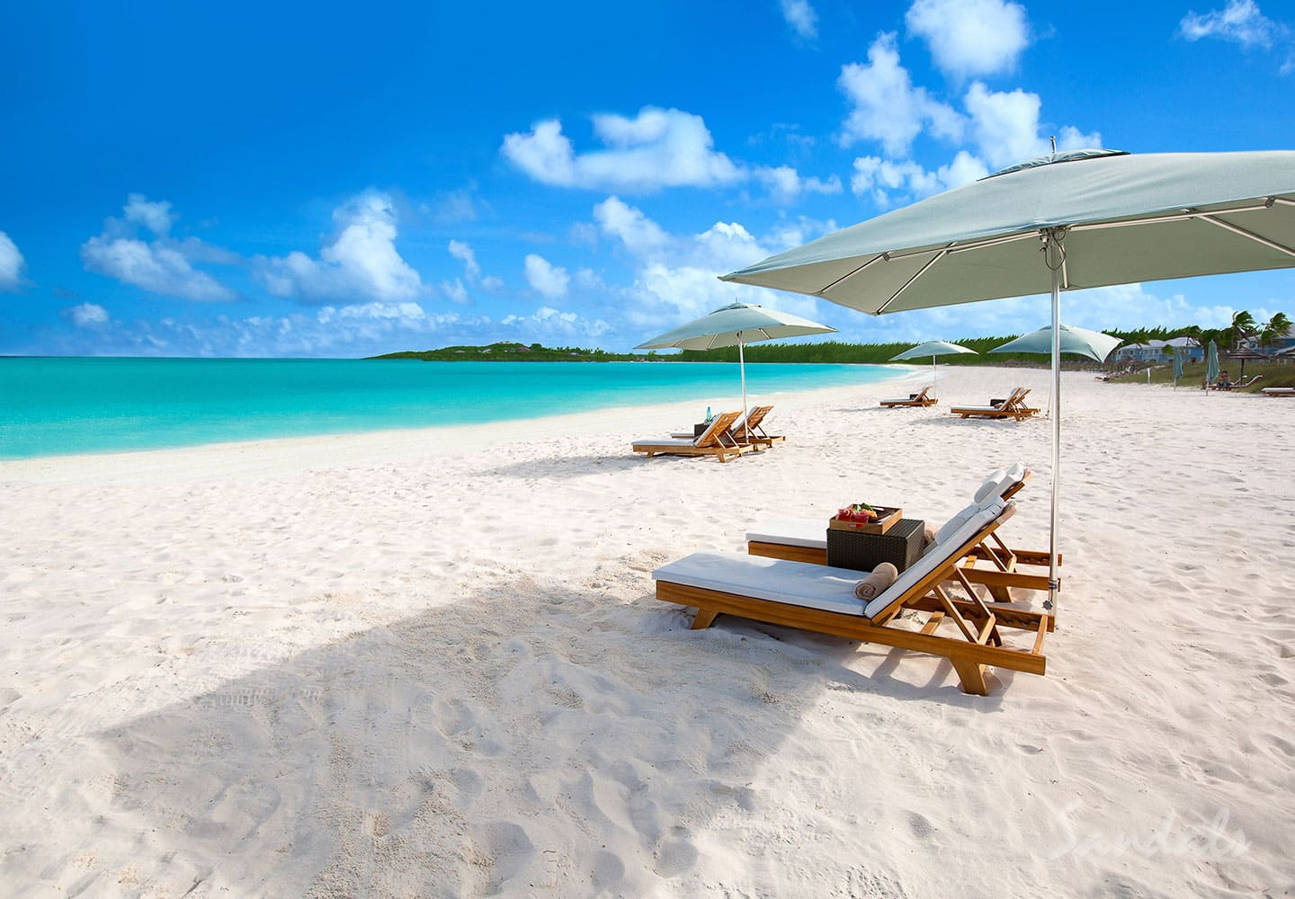 beach and blue water in front of the Sandals Emerald Bay Golf and Spa tennis resort, Great Exuma, Bahamas, perfect for all inclusive vacations adults only