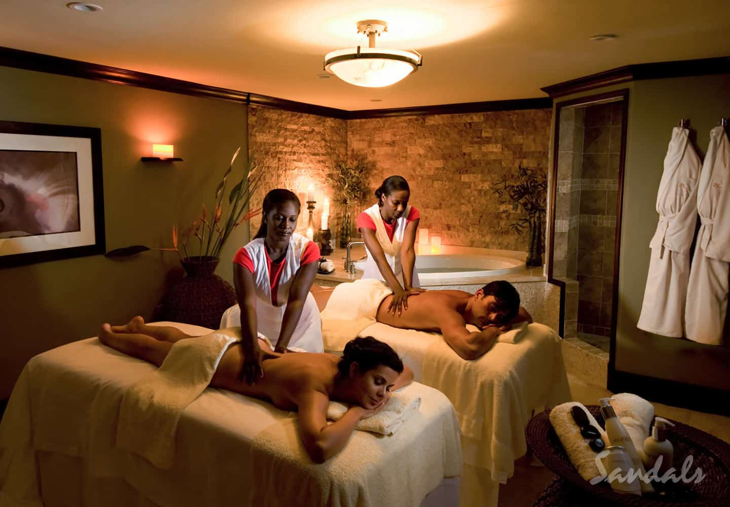 couple in a spa, getting a massage at Sandals Grande St. Lucian spa and beach resort St Lucia, ideal for luxury all inclusive vacations adults only, planned by Southern Travel Agency Augusta, GA