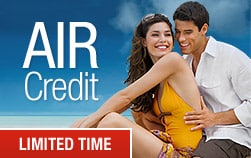 couple sit next with each other, smiling, air credit limited time Sandals resorts promotion