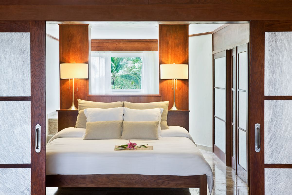 luxury suite at the Excellence Punta Cana Resort in the Dominican Republic, all inclusive group vacation packages
