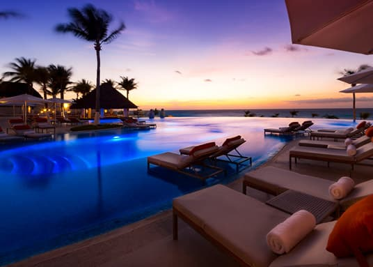 swimming pool at the Le Blanc Spa Resort, a Palace Resort in Cancun Mexico, all inclusive group vacation packages