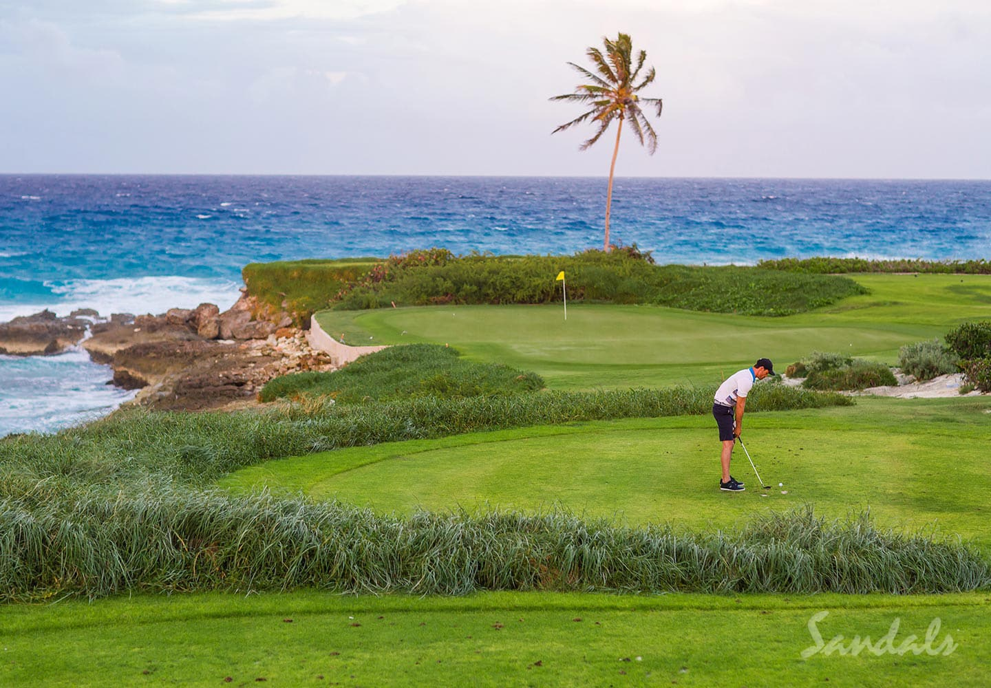 bird eye view of the 18-hole golf course of the Sandals Emerald Bay Golf, Spa and tennis resort, Great Exuma, Bahamas, all inclusive group vacation packages.