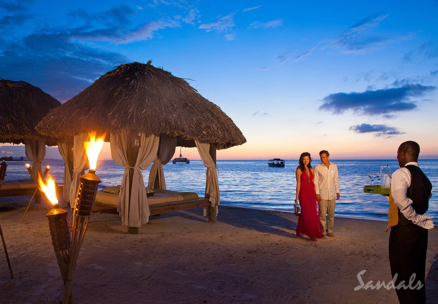 couple on the beach, enjoying a romantic evening with private butler and romantic get-together at the Sandals Montego Bay resort in Jamaica, All Inclusive Adults Only Vacation Packages