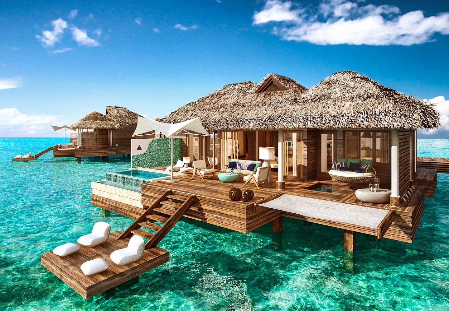 day view of the ultra-luxurious over-the-water bungalows at Sandals Royal Caribbean resort in Jamaica, all inclusive adults only vacation packages