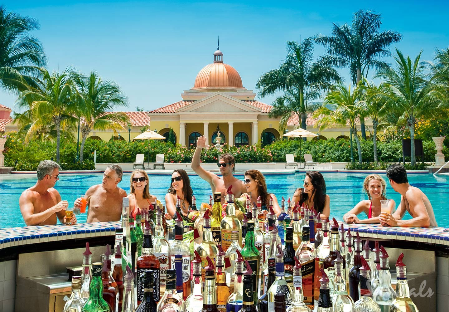 group of people on the pool bar at the Sandals South Coast, former Sandals Whitehouse, resort in Jamaica, all inclusive adults vacation packages