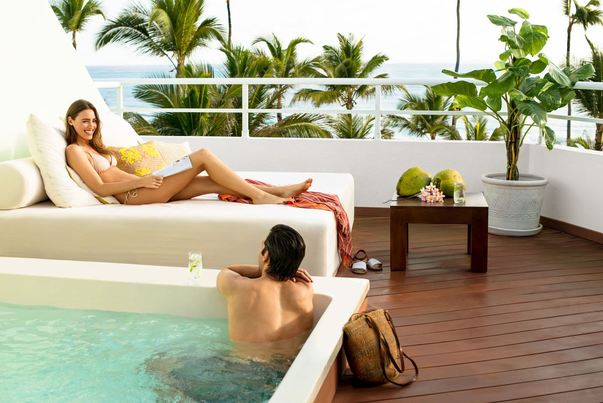 a couple in their private suite and private pool at the Excellence Punta Cana luxury resort, luxury honeymoon vacations