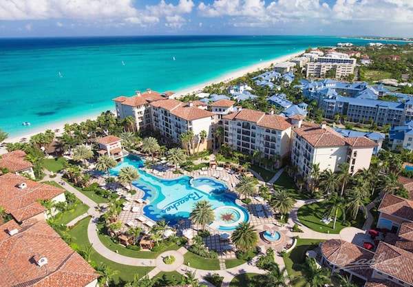 reopening Beaches Turks and Caicos resort pool and rooms with ocean beyond, Sandals resort news
