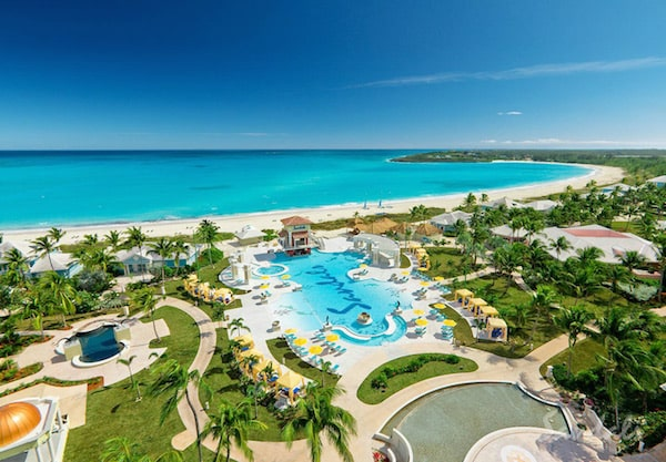 Most romantic all inclusive resorts Sandals Emerald Bay pool and blue ocean view