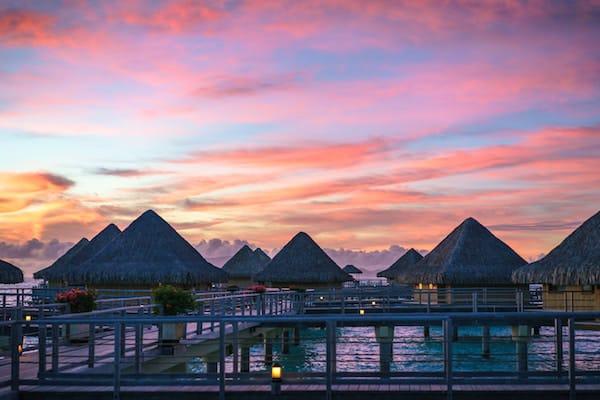 Most romantic all inclusive resorts, bungalows in Bora Bora at sunset