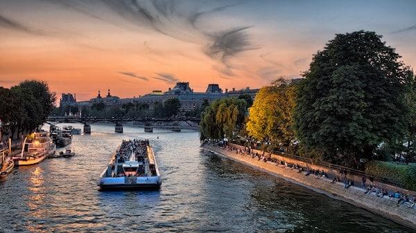 group travel river cruise down Seine Paris