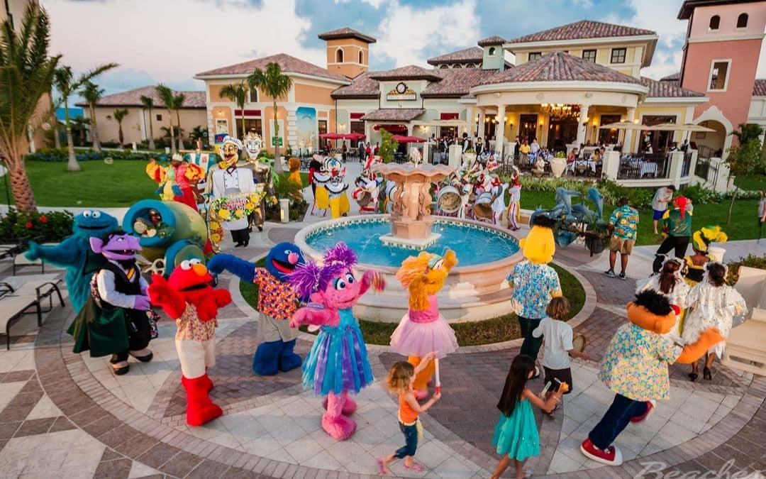 children at the Beaches Turks & Caicos resort are dancing around the resort fountain