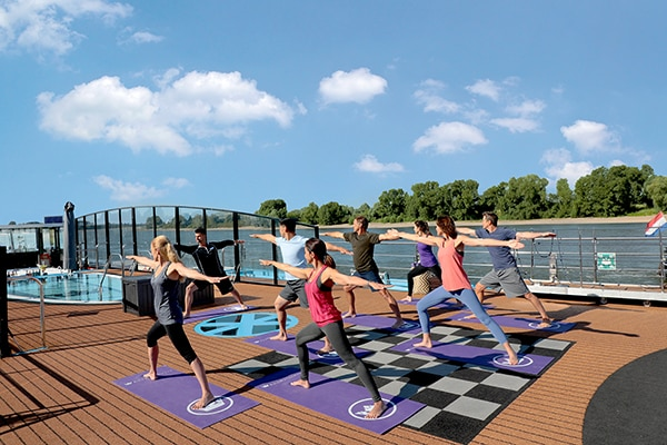 people attending a yoga class on board of an AmaWaterways river cruise