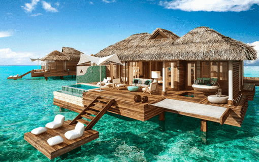 over-the-water bungalows at the Sandals Royal Caribbean Resort and Private Island in Jamaica, perfect location for luxury travel packages, planned by Southern Travel Agency Augusta, GA