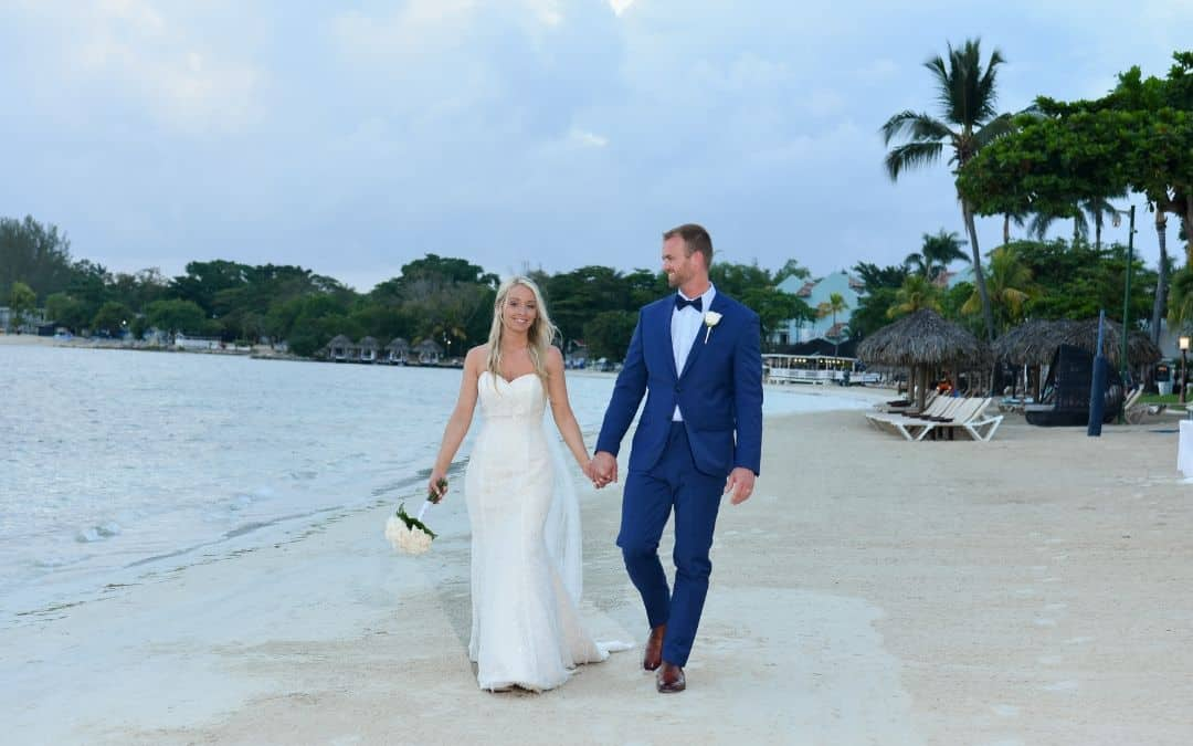 couple celebrating their Sandals Negril Jamaica wedding and honeymoon