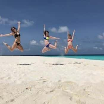 girls jumping in the air, The One & Only Reethi Rah Maldives Resort Hotel