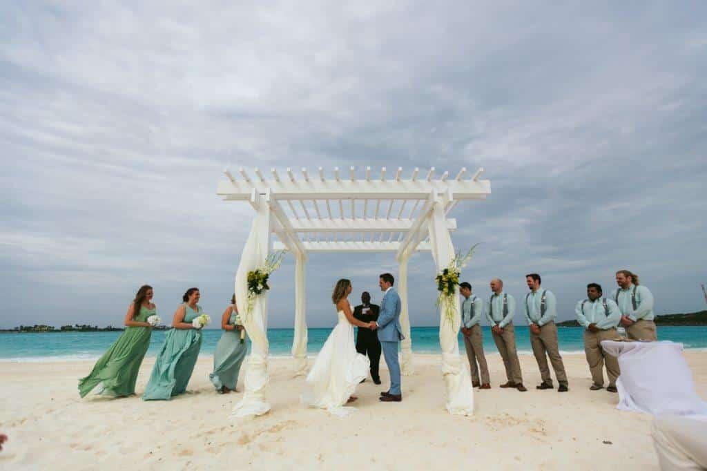 destination wedding at sandals emerald bay beach ceremony